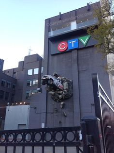 "The CTV station in Toronto, I love that car coming out of the building, the news station motto is ""breaking news"""