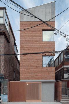 FHHH Friends arranges flexible rooms over split levels in slender Seoul house