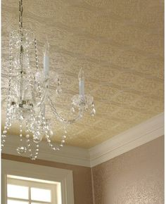 paintable embossed wallpaper mimicks look of tin ceiling, hides concrete situation & will definitely look better with chandeliers & pendant lights than the concrete would.