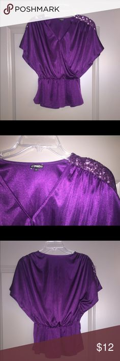 Express Sequin Peplum Top This top is like new, worn once, and is a size extra small. There is a button in the front to adjust how open you would like the V Neck to be. Tops Blouses