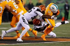 Miami Dolphins running back Isaiah Pead (22) is tackled by Cincinnati Bengals linebacker Karlos Dansby (56) and defensive end Will Clarke (93) during the first half of an NFL football game, Thursday, Sept. 29, 2016, in Cincinnati. Photo: Gary Landers, AP / AP