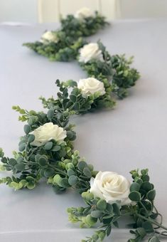 garland of flowers Realistic looking artificial eucalyptus garland. Includes realistic, white artificial roses Perfect wedding table centerpiece or arbor garland. This garland mea Barn Wedding Centerpieces, Rose Centerpieces, Garland Wedding, Wedding Flower Arrangements, Wedding Decorations, Centerpiece Ideas, Rose Garland, Greenery Garland, White Roses Wedding
