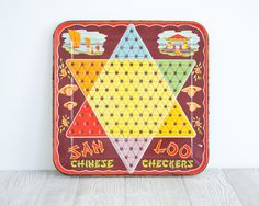 Vintage Game Board, Chinese Checkers Metal. $32.00, via Etsy.