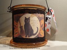 This charming vintage Halloween lantern is great for indoor decorating and the theme can be replicated on luminaries outdoors on brown paper bags--small size--and some stenciling.