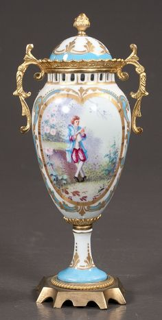 """French bronze mounted Sevres porcelain white and blue cabinet vase, the double handled vase signed """"Luc"""", 9"""" high"""