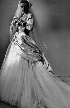 Dior, 1949    'Fidelity' an evening gown of white satin and tulle