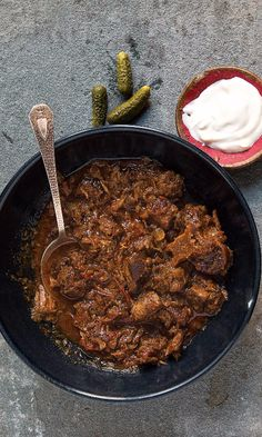This stew is made with a generous amount of paprika and cooked down until the meat is fork-tender and the sauce thick and hearty. Unlike other spices, Hungarian paprika powder should not be fried in the cooking oil. Hungarian Cuisine, European Cuisine, Hungarian Recipes, Hungarian Food, Croatian Recipes, Bosnian Recipes, Korma, Biryani, Hungary