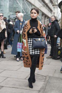 Miroslava Duma played houndstooth against a knit leopard-print cape. Street Style London Fashion Week #LFW