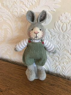 Say hello to this gorgeous bunny! He is hand knitted using beautiful baby alpaca wool. His cute little overalls and jumper are made from 100% cotton and are removable. He is made using all new materials and is stuffed with crest-a-Lon fibre filling. This bunny is approximately 25cm tall