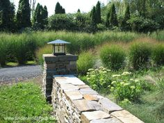 At this South Hero VT property the driveway entrance is marked by a granite pillar topped with a lantern to help light the way.