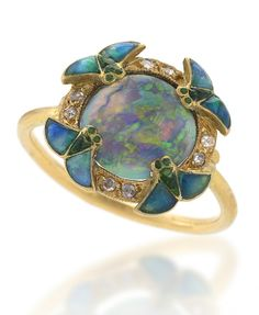 A French Art Nouveau 18 karat gold and enamel ring with opal and diamonds by Eugene Feuillatre. The ring has a center black opal, surrounded by 8 rose-cut diamonds and 4 enamel wings. The closed gallery is decorated with a gold/enamel scrollwork design. circa 1900's.