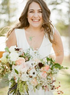 Bride Lillie shares her cozy, eclectic barn wedding at Lake Oconee. Please meet today's bride, Lillie! With its eclectic style and joyful atmosphere, her wedding to Blake easily became an office favorite in our tenth-anniversary issue. From the beautiful location of Lake Oconee (where they shared their first kiss!), to romantic blooms that could make …