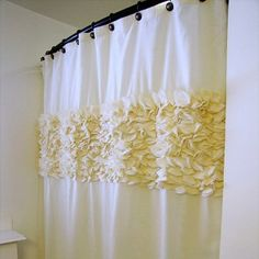 This Pretty Petal Shower Curtain would look beautiful in a master bathroom. It really adds a soft touch to the bathroom.You could use this technique to make a faux wall in a studio apartment, as well.
