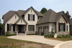 rock stucco exterior home | Bridlewood Homes - Who We Are: Awards