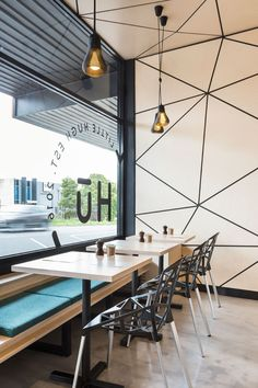 When designing this modern cafe, the designers experimented with computational geometry and Delaunay triangulation to develop the interior concept and branding. This resulted in the creation of the tessellated pattern that wraps from the walls around to the ceiling.