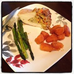#chefdarrick makes porkchop stuffed with homemade stuffing, roasted sweet potatoes, and  asparagus