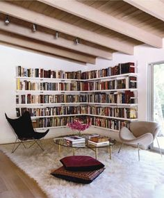Love this reading corner idea but I'd want more of a cozy feel. Love the floating bookshelves.