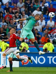 #EURO2016 Pepe of Portugal vies with Zoltan Stieber of Hungary during the UEFA EURO 2016 Group F match between Hungary and Portugal at Stade de Lyon in Lyon...