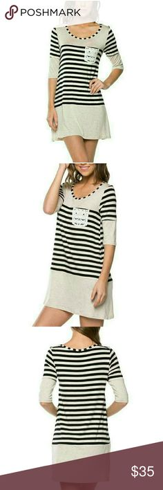 NEW STRIPED DRESS WITH LACE POCKET New oat color dress with black stripes & lace pocket. Can be worn as a dress or with leggings.  95% Rayon/5% Spandex Available in S,M,L Length approximately 34 inches BUST SIZE S-33.5-35, M- 36-38, L 38-40 Made in USA?? PRICE IS FIRM 4. Bidden Boutique Dresses Mini