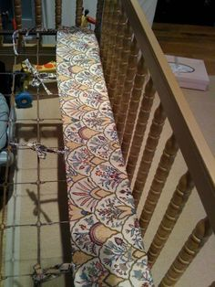 A Better Crib Sheet Design - Rather than having a deck in the center, tie the side panels to the mattress spring so that they can be adjusted as you move the mattress down over time. (or back up for the next baby.)