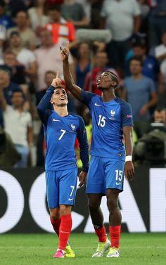Antoine Griezmann (left) celebrates with Paul Pogba