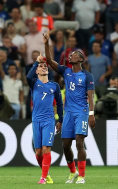 Antoine Griezmann (left) celebrates with Paul Pogba