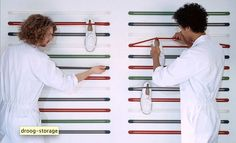 These are $25 from Droog but you could attempt to make your own with wall pegs and bungee cords.