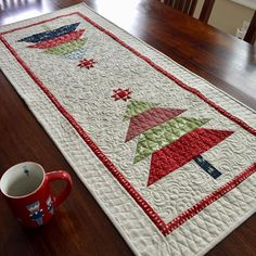 Final finish for I had a couple of blocks left over from a Christmas quilt and in no time I had a new table runner. Xmas Table Runners, Table Runner And Placemats, Table Runner Pattern, Quilted Table Runners, Christmas Tree On Table, Christmas Runner, Christmas Crafts, Christmas Patterns, Christmas Sewing