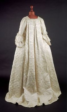 1751-1754, The Museum of London. White silk satin open robe dress with sack-back and with matching petticoat and stomacher, ornamented with wadded and corded quilting and lined with white silk.