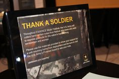 Visitors to the Army Strong Zone at 2012 Essence Music Festival leave thank you notes for Soldiers returning home from deployment.