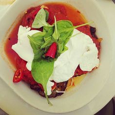 Poached eggs, eggplant and spicy tomato