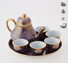 Benjarong tea set - Candle drop pattern on dark blue  Add style and sophistication to your drinking habits with this finely crafted porcelain tea set. Complete with 5 chinese-style teacup, teapot, and serving tray. Made by the technique of craftsmanship originally exclusive for the Thai royal court, with multiple layers of exquisitely hand-painted Thai arts and relief glaze to emphasize its Candle drop pattern and background against the beautiful 18k gold accent. Benjarong teaset is the…