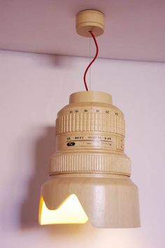 A Wooden Hanging Lamp Shaped Like a Giant Nikon 14 24mm Lens