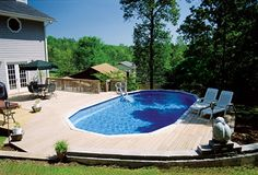 semi buried above ground pool with deck in backyard Pool Porch, Backyard Pool Landscaping, Backyard Pool Designs, Small Backyard Pools, Backyard Ideas, Small Backyards, Landscaping Ideas, Above Ground Pool Decks, In Ground Pools