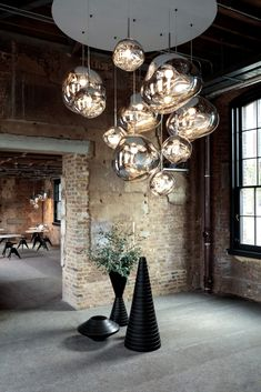 MELT by Tom Dixon Each light is a bold statement in its own right; however, we think our lighting often sits best in multiples. Endless reflections, spatial play and graphic arrangements showcase the extraordinary in our range. #tomdixon #tomdixonMELT #lighting #interior #design #homedecor #inspiration