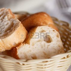 Fresh white bread in a basket on an old wooden table Stock Photo