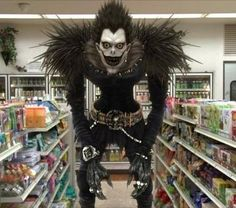 Death Note Cosplay: Ryuk-Shinigami. I would probably scream and run away if I saw this at the store.