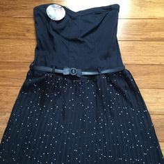 Strapless navy blue dress Strapless navy blue dress. Polka dots on the skirt with matching bow belt. Stretchy back. Brand new never worn - with tags! Dresses Strapless