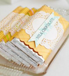 USE FOR WRAPPING IDEA (no actual candy inside) : Candy-shaped gift wrap (chocolate bar) : cover flat and/or rectangular gift in foil, use scrapbook and/or gift paper to create wrapper >> w/ or w/out decorative ID label