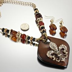 NEW!  BEAUTIFUL FLEUR DE LIS NECKLACE AND EARRING SET.  COLORS ARE BROWN AND BLACK - GOLD.