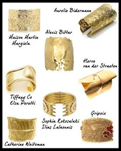 gold cuffs. one on each wrist.
