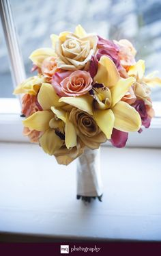 Wedding bouquet with shades of pale yellow and mauve