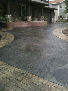Stamped driveway with stone skin texture/cobblestone stamp border
