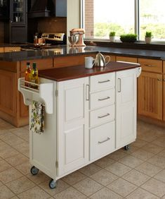 Don't feel limited by a small kitchen space. Get design inspiration from these charming small kitchen designs. Small Kitchen Storage, Small Space Kitchen, Diy Kitchen, Kitchen Organization, Kitchen Decor, Awesome Kitchen, Organization Ideas, Extra Storage, Organization Station