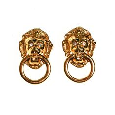 """DESCRIPTION Kenneth Jay Lane Lions Head Doorknocker EarringsCouture Designer StyleMr. Lane's Inspiration were gold door knocker handles on fine pieces of furniture and doors. Gold Tone, Clip on, DanglingThese iconic earrings are classicDETAILS1980s EraDesigner Signed KJL for AvonGold PlatedRhinestone EyesClip BacksExcellent Vintage Condition MEASUREMENTS1 3/4"""" x 1 1/8"""""""