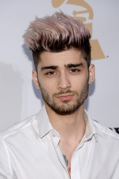 You, like us, may have thought neon green was the craziest shade Zayn would ever go for — until he rocked pink spikes the same hue as Bazooka bubblegum at the Grammy's.