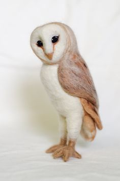 What a beautiful centerpiece to have in any home. Imagine her watching over a mantle or a bookshelf. This Barn Owl Sculpture stands 7 inches tall and is made entirely out of Merino wool, aside for the feet, which have a bit of wire to give structure and support. She is not a toy