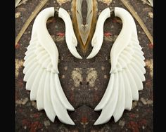 Yafah Swans - Organic Bone Earrings - someday I will have a pair or two of faux gauge earrings