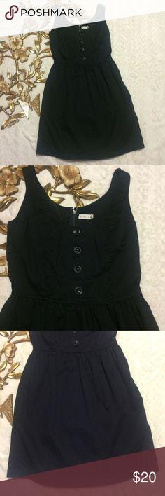 "Tulle Black Sleeveless Mini Dress Tulle Black Sleeveless Mini Dress side pockets lined back zipper and hook closure measurements taken laying flat: 33"" length 15"" armpit to armpit 12-1/2"" waist Tulle Dresses Mini"