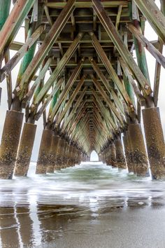 Under The Long Pier  #Pier #CherryGrove #UnderThePier #UnderTheLongPier #LongPier #Ocean #Wave #Waves #Beach #Water #Sand #Piers #WoodenPier #TunnelPier #PierTunnel #LongExposure #Exposure #Cloud #Cloudy #Overcast  #Photo #PhotoOfTheDay #POTD #Photography #Photographer #Canon #CanonPhotographer